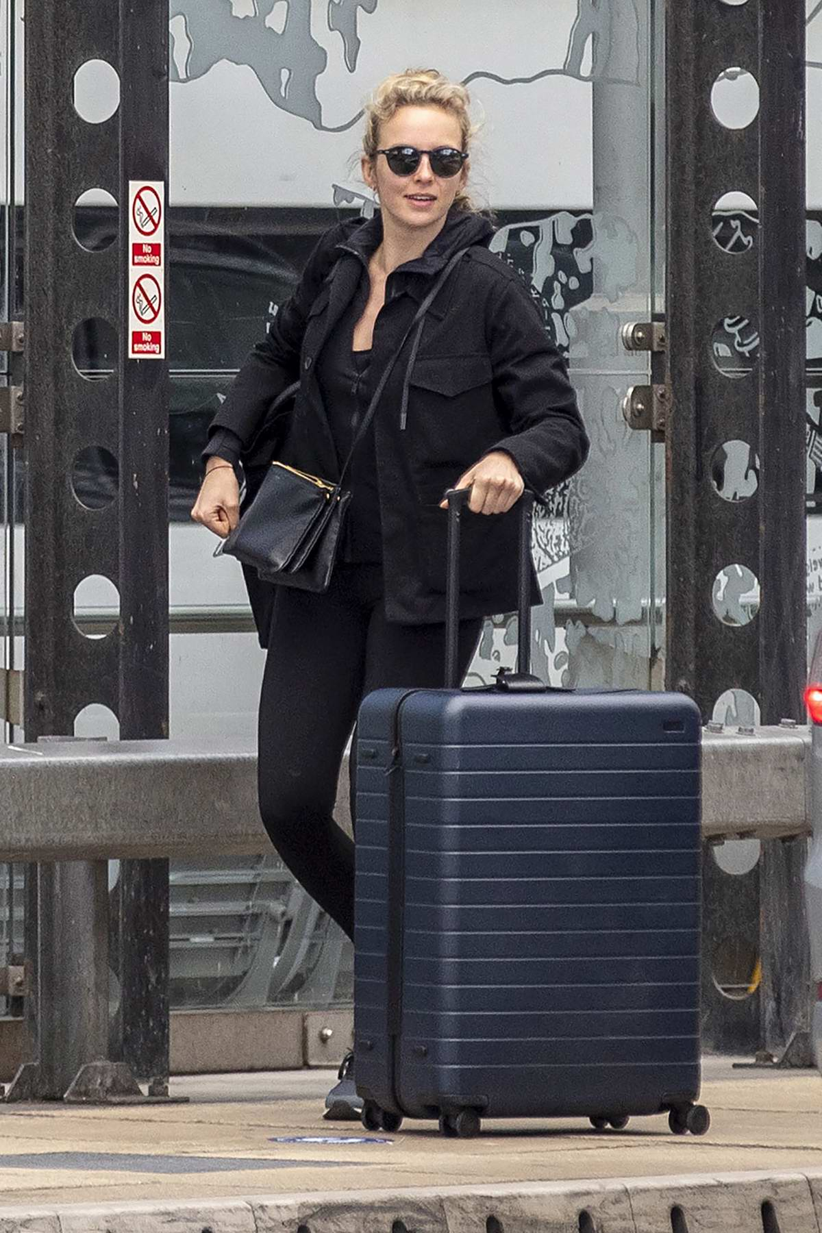 Jodie Comer dons all-black as she arrives to catch a train from Liverpool Lime street station in Liverpool, UK