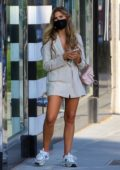 Kara Del Toro waits to pick up her makeup at Sephora cosmetics store in Beverly Hills, California