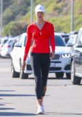 Karlie Kloss sports a red top and black leggings while out for a morning run along the coast in Malibu, California