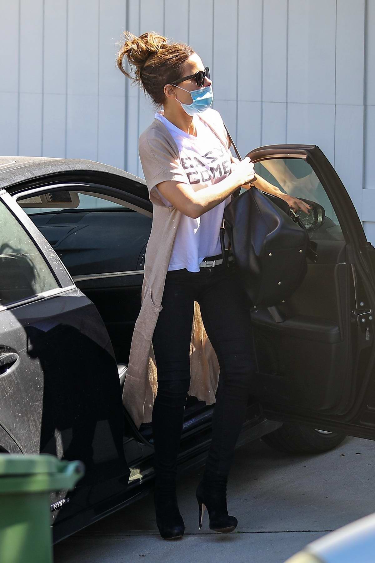 Kate Beckinsale seen wearing a mask as she arrives home with a girlfriend in Pacific Palisades, California