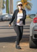 Katherine Schwarzenegger caresses her baby bump while out for a stroll in Venice beach, California