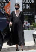 Katherine Schwarzenegger makes a stop at a Starbucks to grab an iced coffee while running errands in Los Angeles