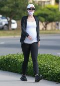 Katherine Schwarzenegger shows her growing baby bump as she takes her daily walk in Santa Monica, California