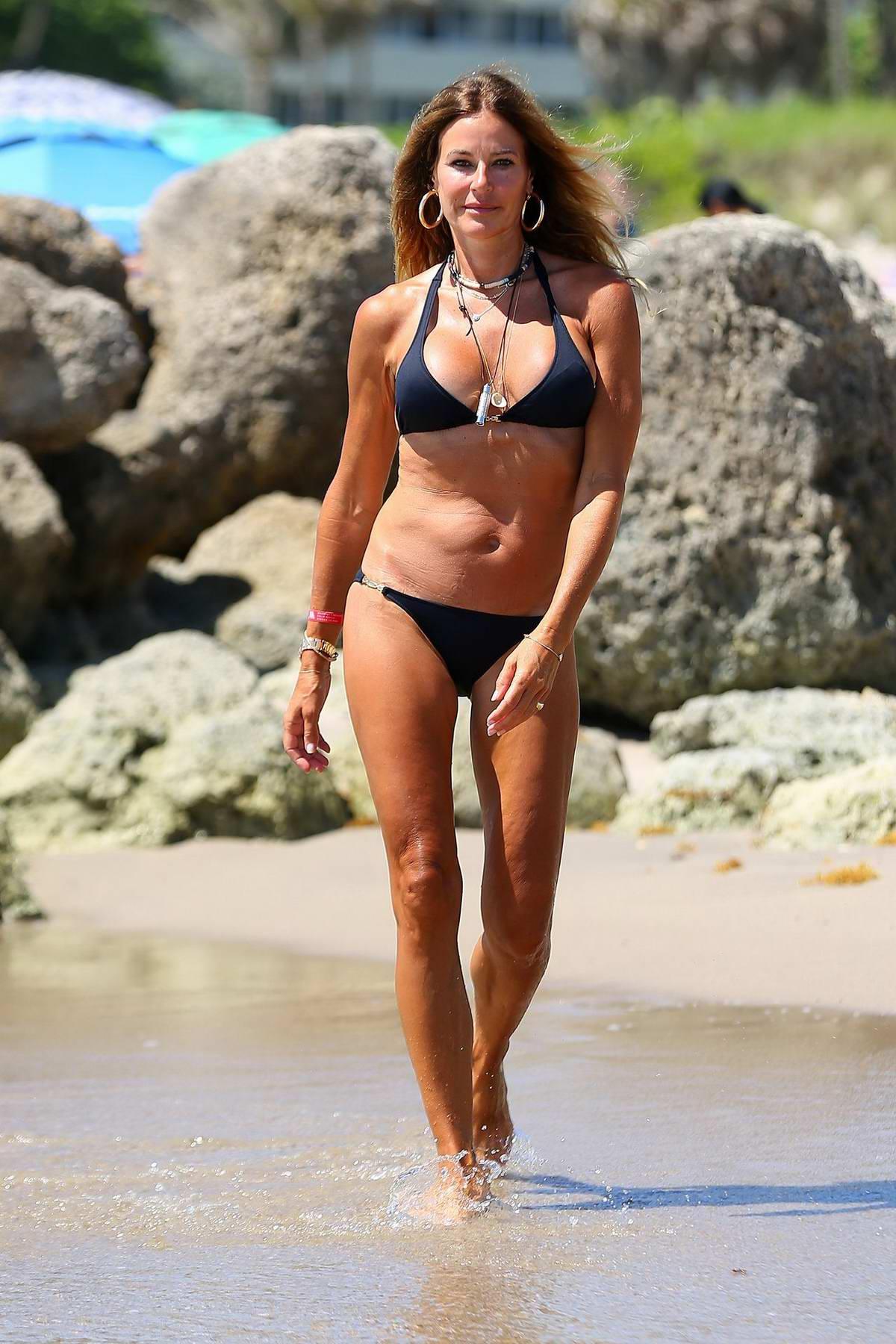 Kelly Bensimon sports a black bikini for a beach day in Deerfield Beach, Florida