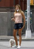 Kelly Bensimon wears tank top and shorts as she steps out to walk her dog with a friend in New York City