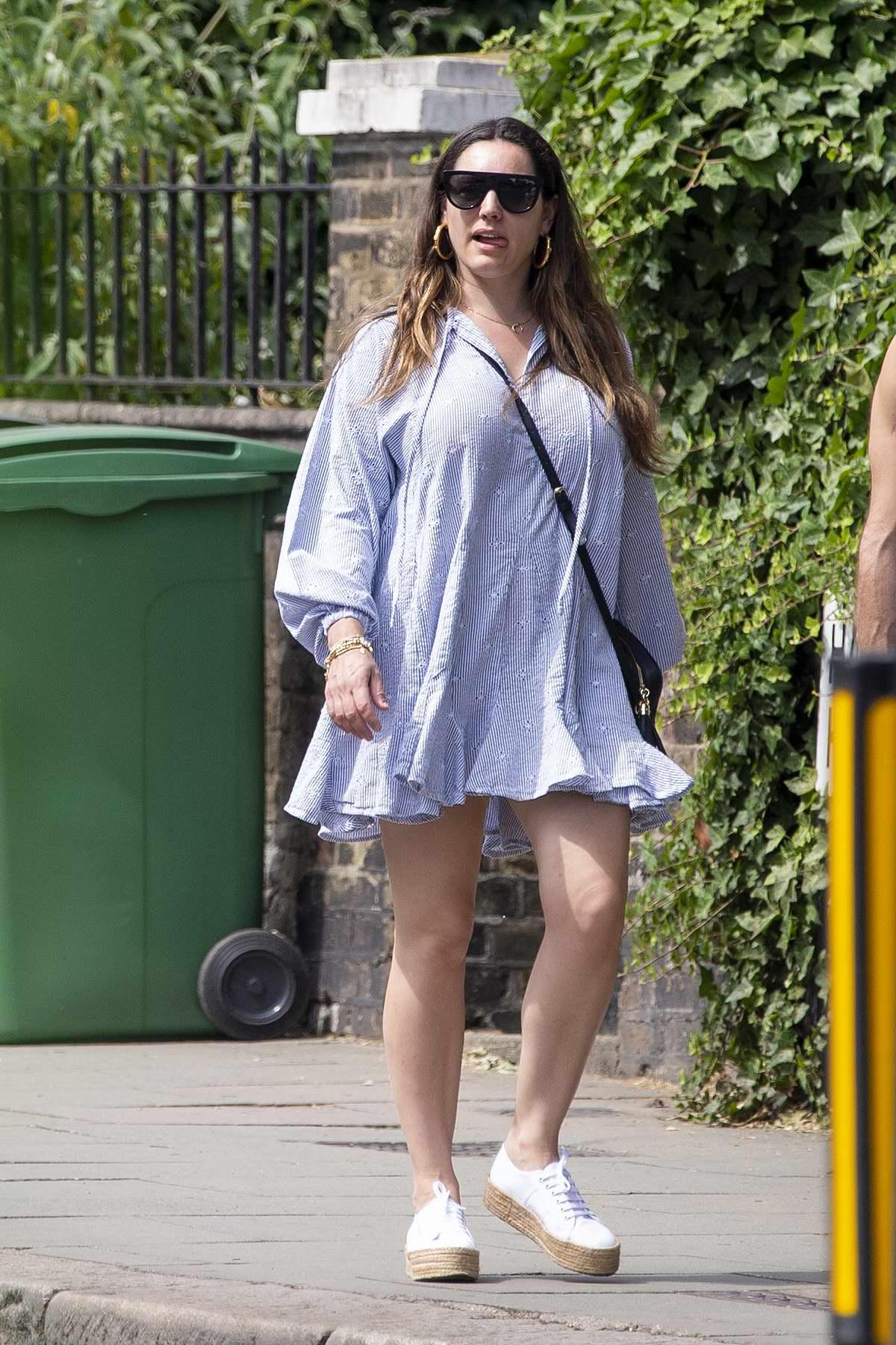 Kelly Brook looks great in a light blue mini dress as she steps out in Belsize Park, London, UK