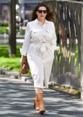 Kelly Brook looks stylish in a white dress as she arrives at Heart radio in London, UK