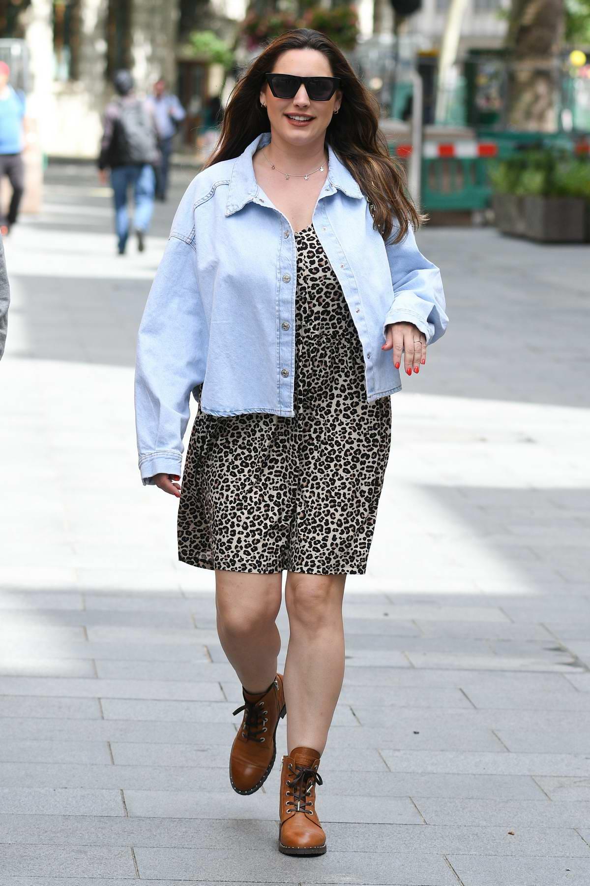 Kelly Brook wears an animal print as she arrives at the Global Radio Studios in London, UK