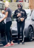 Kristen Stewart rocks a tie-dye hoodie and leggings as she steps out for coffee with Dylan Meyer in Los Angeles