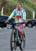 Lais Ribeiro spotted in a colorful tie-dye hoodie while out riding a bicycle with fiance Joakim Noah in Malibu, California