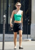 Lily-Rose Depp rocks a green crop top and black mini skirt as she steps out in Paris, France
