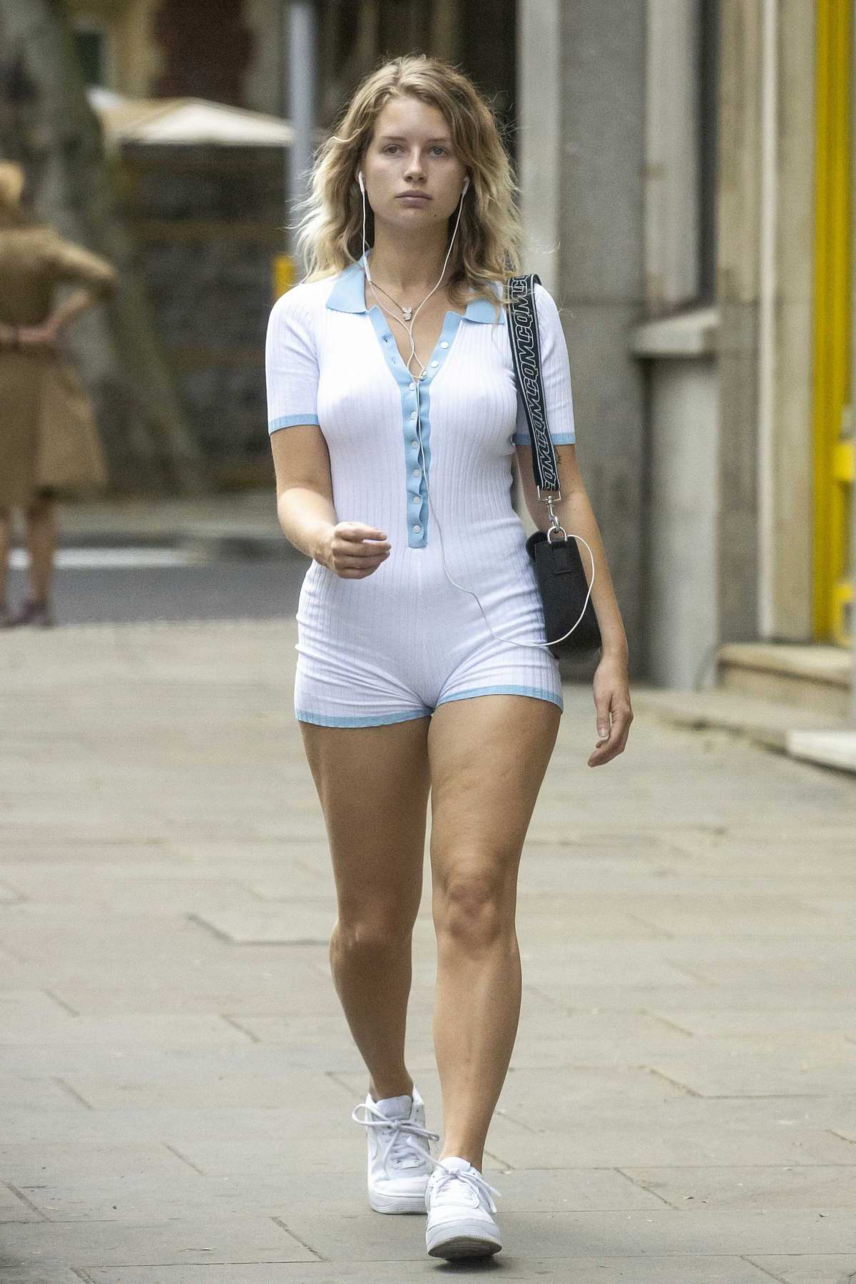 Lottie Moss sports a white romper during a solo outing in London, UK