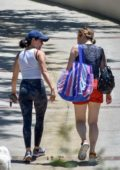 Lucy Hale catches up with a friend while out for a walk with her dog Elvis in Studio City, California