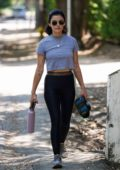 Lucy Hale opts for a grey crop top and black leggings while out for an afternoon walk in Studio City, California