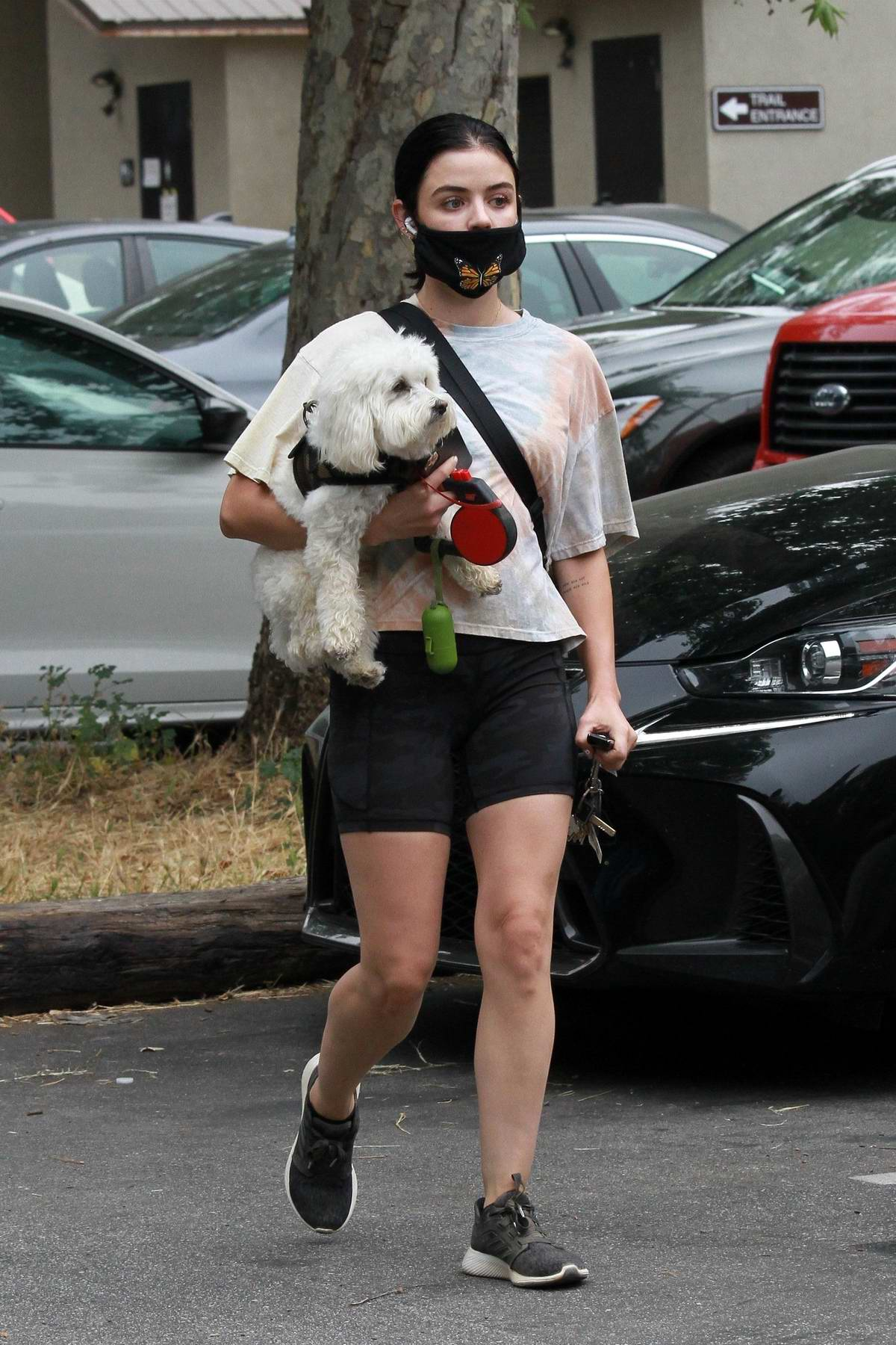 Lucy Hale puts on a leggy display in camo shorts paired with a tie-dye tee while out for a hike with her dog in Los Angeles