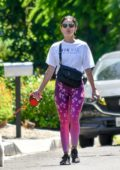 Lucy Hale sports a floral print tie-dye leggings as she steps out to walk her pup Elvis in Los Angeles