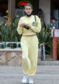 Madison Beer goes makeup free in a yellow sweatsuit as she steps out with a friend in Los Angeles