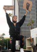 Madison Beer spotted on top of a car while protesting in Hollywood, California