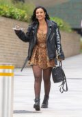 Maya Jama is all smiles as she leaves Channel 4 Studios holding a plate of dessert in London, UK