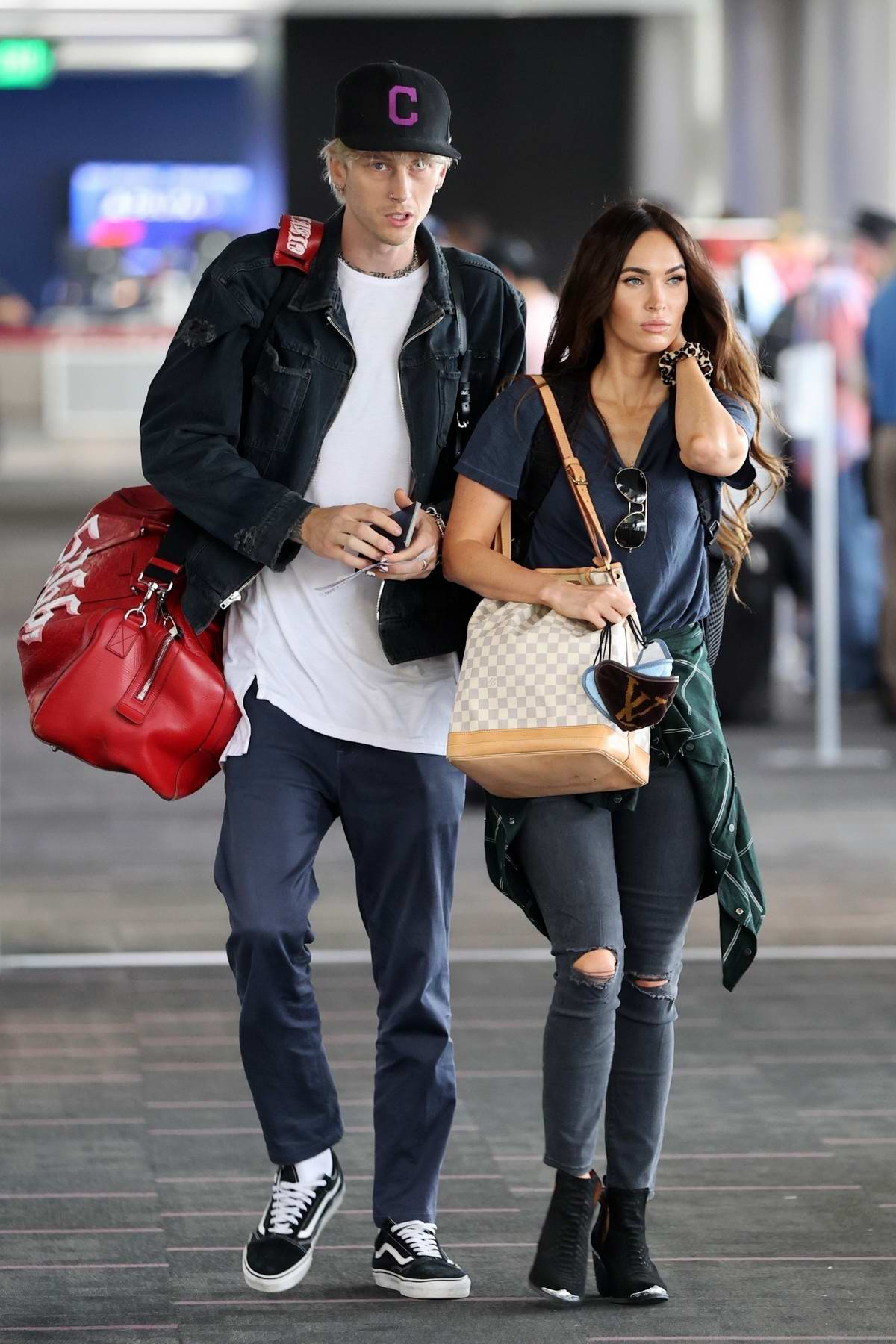 Megan Fox and Machine Gun Kelly are seen arriving at LAX airport in Los Angeles