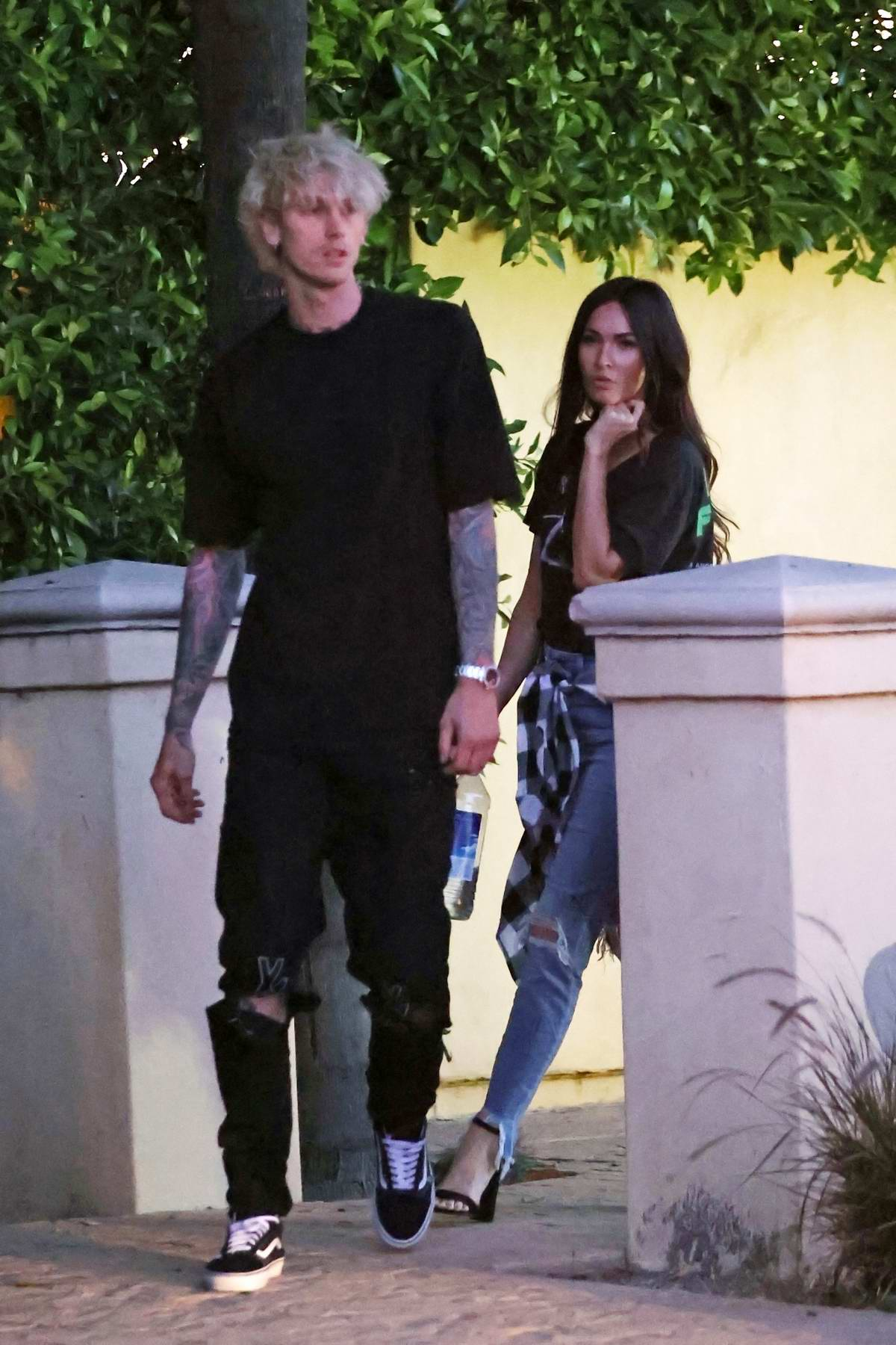 Megan Fox and Machine Gun Kelly seen leaving his mansion in Los Angeles, California