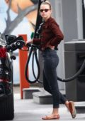 Mia Goth looks stylish in brown denim jacket with skinny jeans while making a pit stop at a gas station in Los Angeles