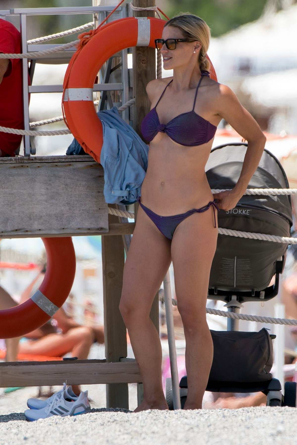 Michelle Hunziker looks fab in a purple bikini during a relaxing beach day in Varigotti, Liguria, Italy