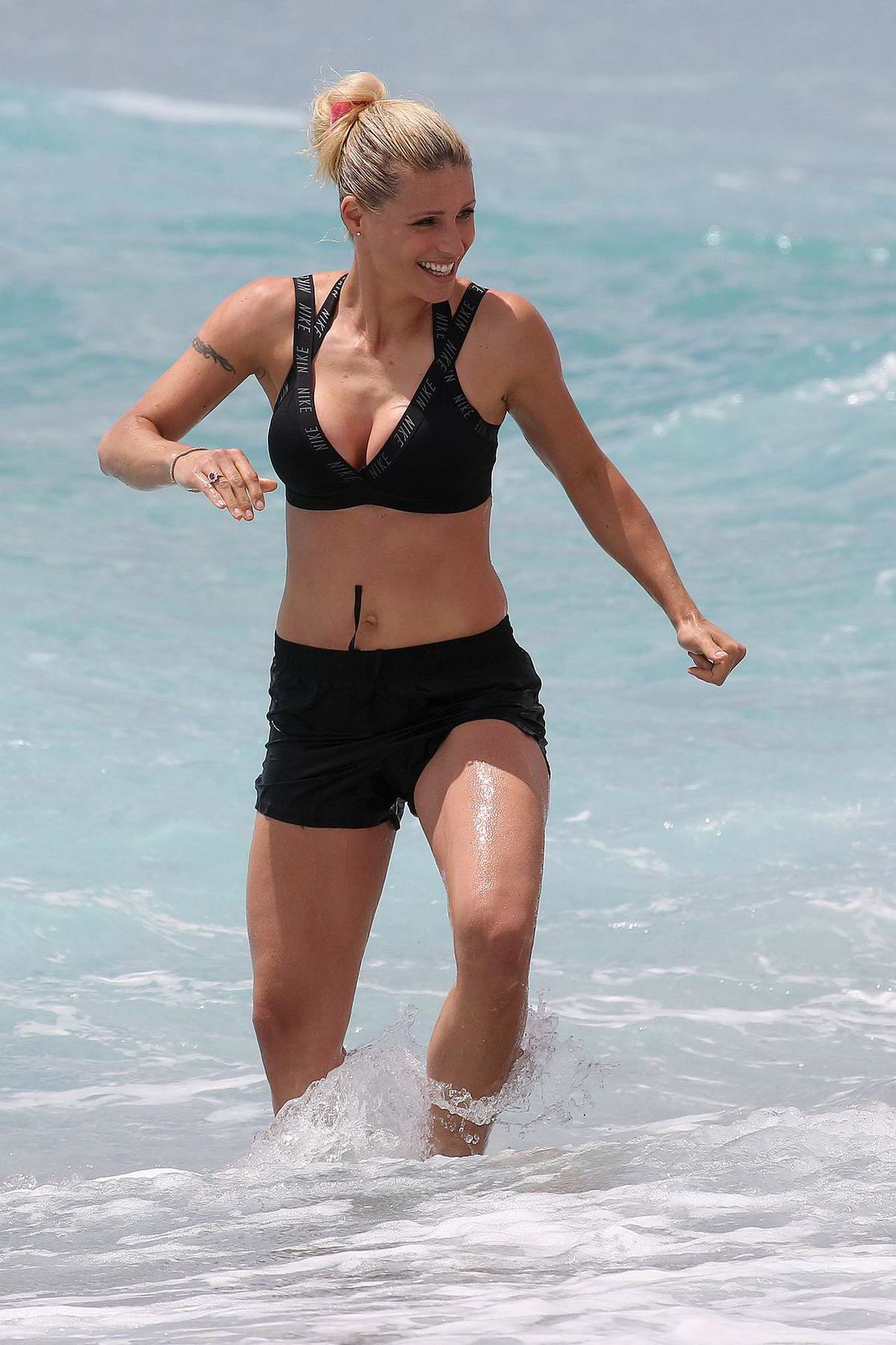 Michelle Hunziker shows off her fit body as she hits the beach with friends in Varigotti, Italy