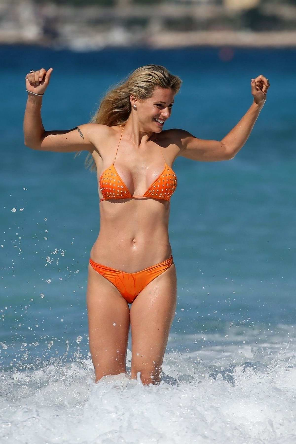 Michelle Hunziker sports an orange bikini during a beach day in Varigotti, Italy