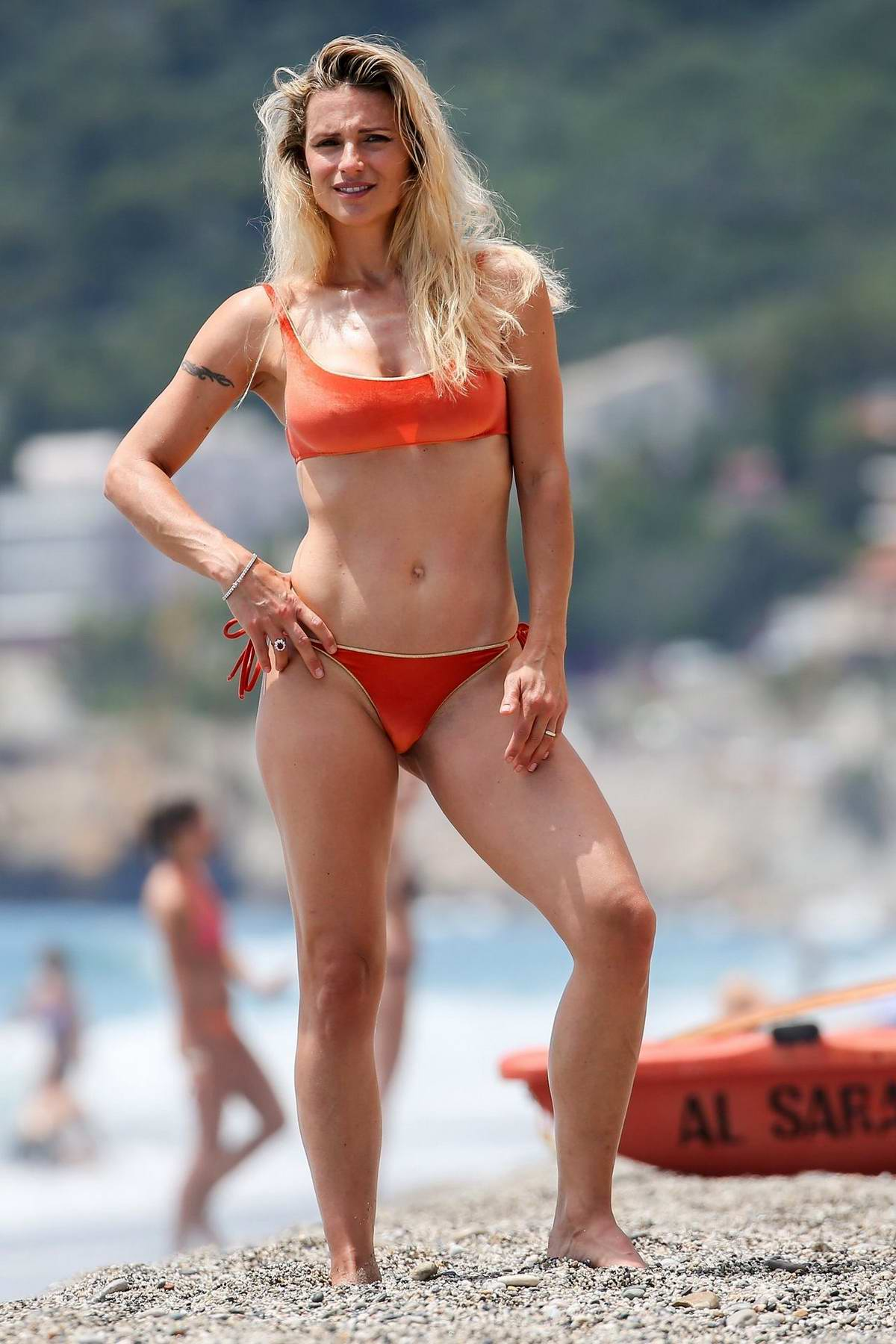 Michelle Hunziker wears a red bikini as she goes for a swim in Varigotti, Italy