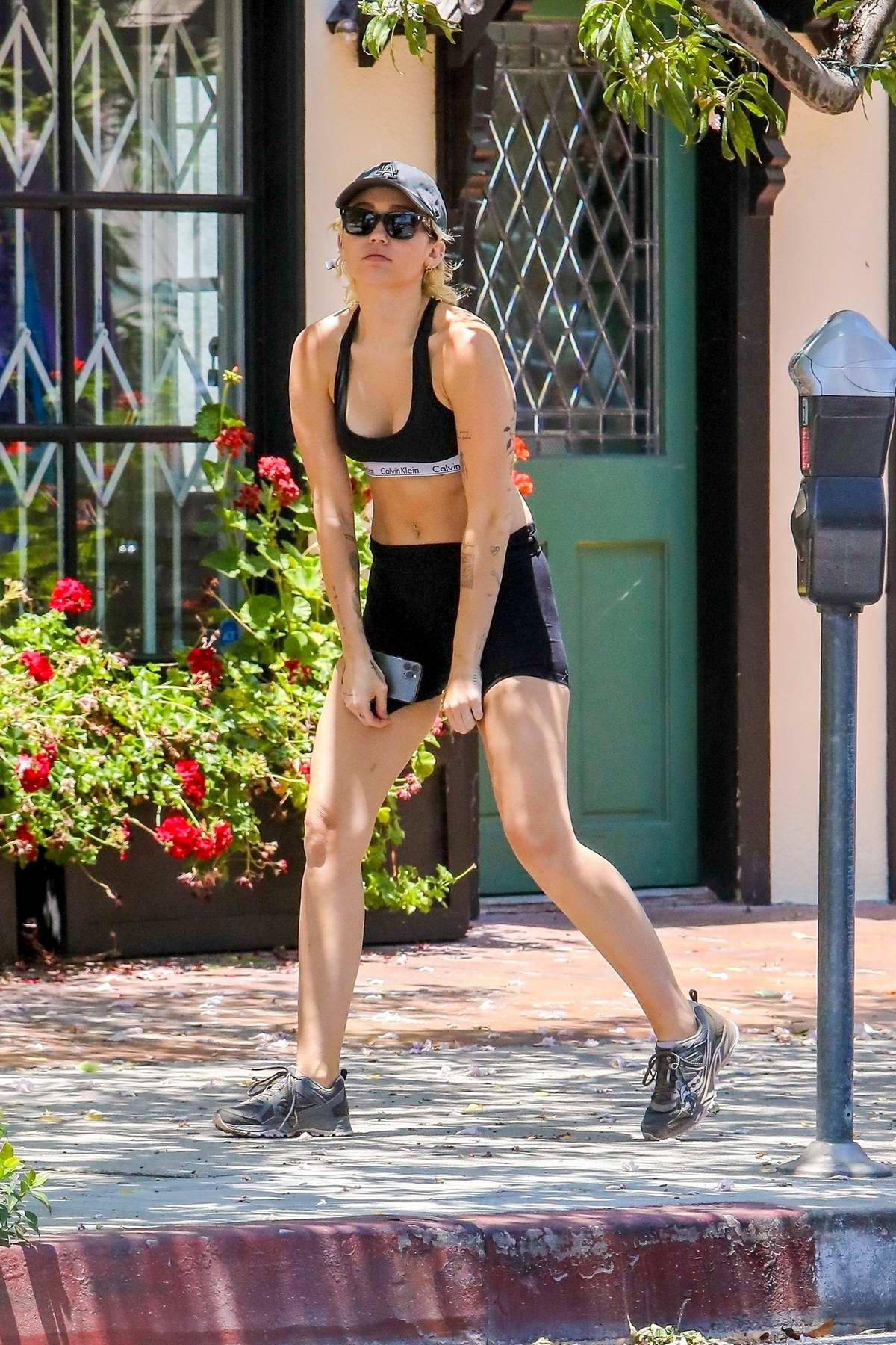 Miley Cyrus displays her toned figure in a crop top and shorts as she goes hiking with Cody Simpson in Los Angeles