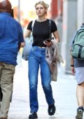 Nicola Peltz wears a black crop top and jeans while out for some shopping with her mother in New York City