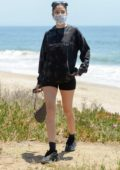 Nicole Williams flaunts her legs while out for a walk on the beach in Malibu, California