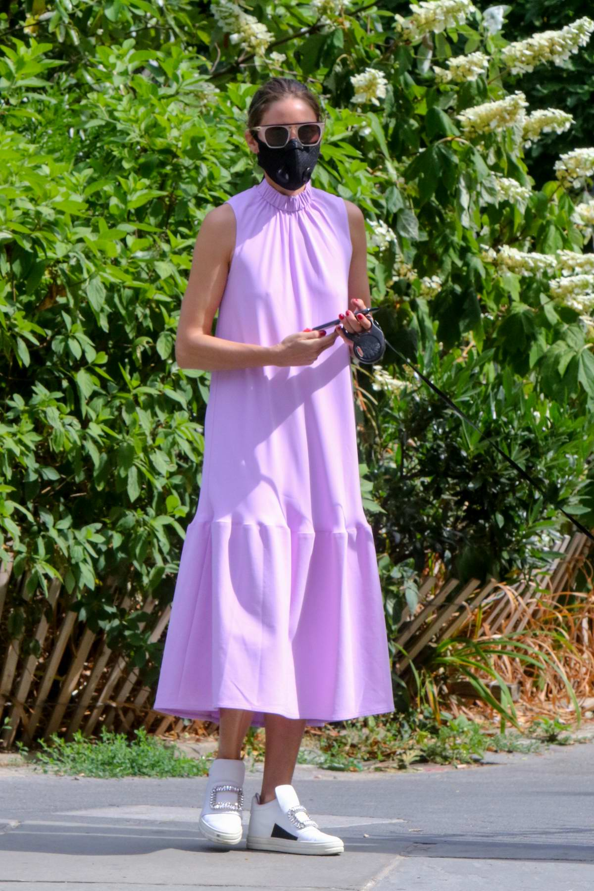 Olivia Palermo looks stunning in a lavender summer dress while out to walk her dog in Brooklyn, New York