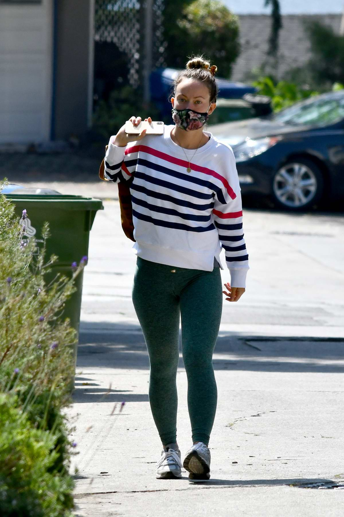Olivia Wilde sports green leggings with a striped sweatshirt as she steps out in Los Angeles