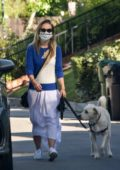 Olivia Wilde wears a stylish mask as she walks her dog in her Los Angeles