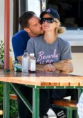Paris Hilton and new boyfriend Carter Reum pack on the PDA during a romantic lunch in Malibu, California