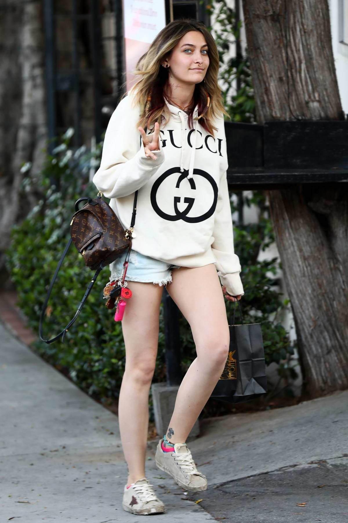 Paris Jackson puts on a leggy display in denim shorts paired with a Gucci hoodie as she steps out in Los Angeles