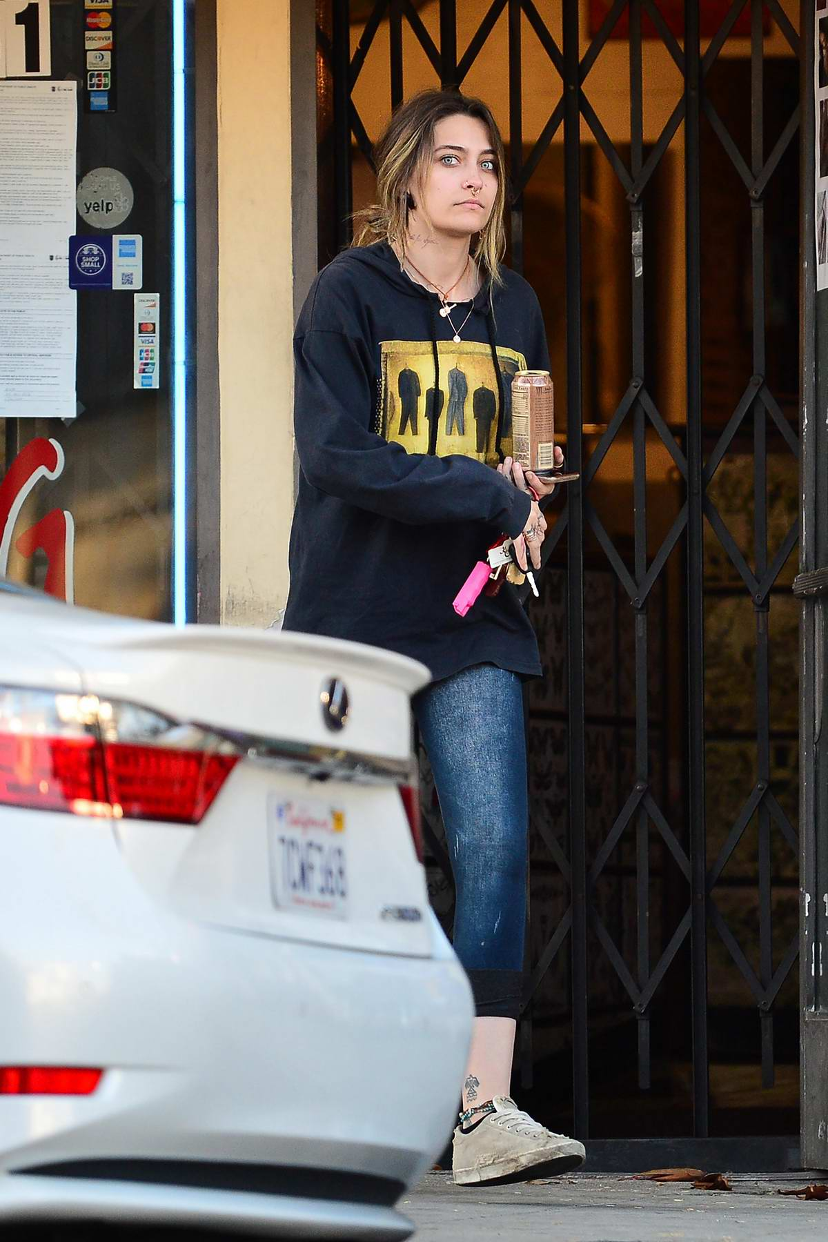 Paris Jackson sports a new neck tattoo as she leaves a tattoo parlor in West Hollywood, California
