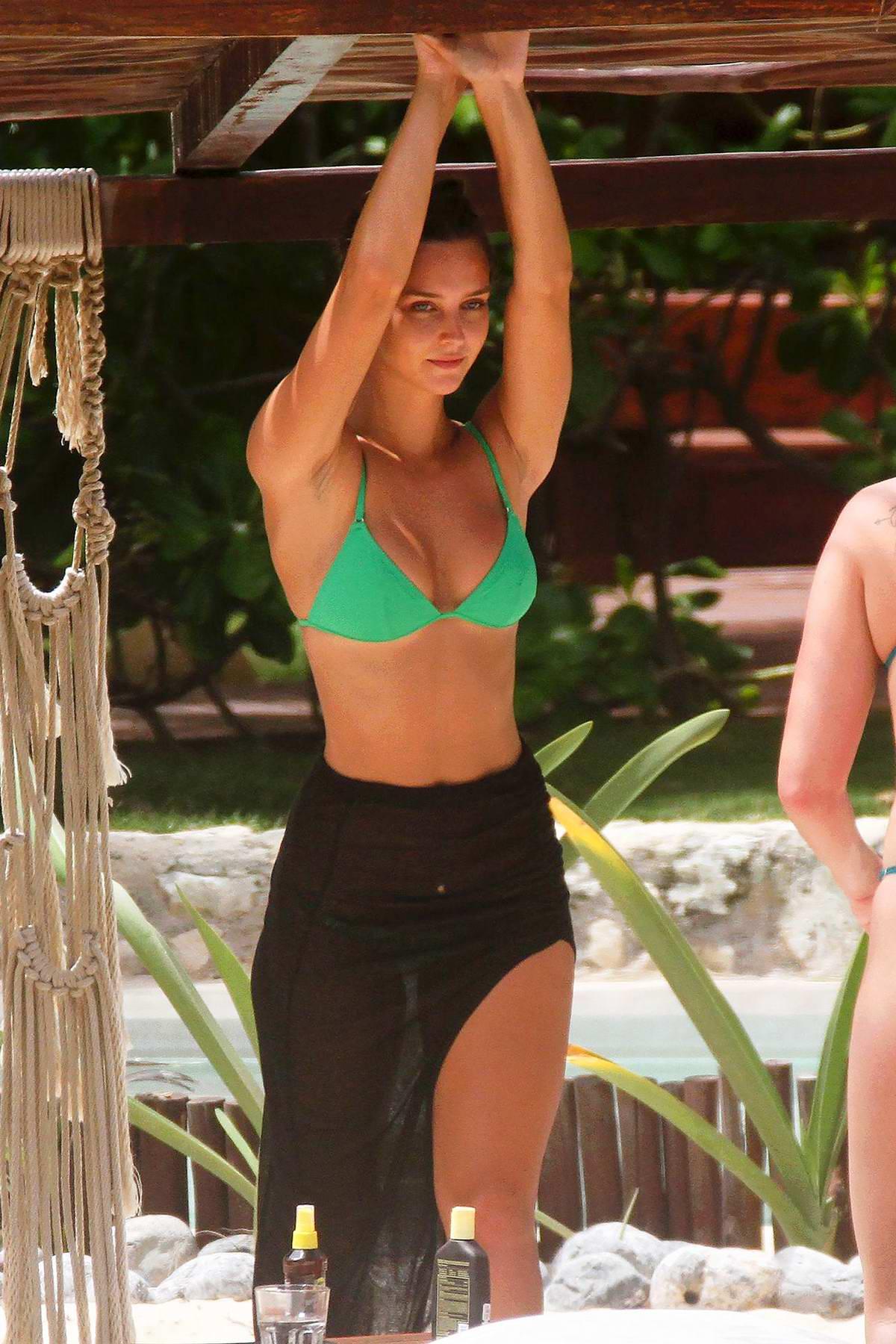 Rachel Cook sports a green bikini while enjoying the sun with boyfriend Tyler Worf in Tulum, Mexico