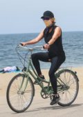 Reese Witherspoon dons all-black for a bike ride along the coast in Malibu, California