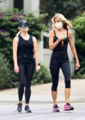 Reese Witherspoon sports all-black while out for a walk with her yoga teacher in Brentwood, California