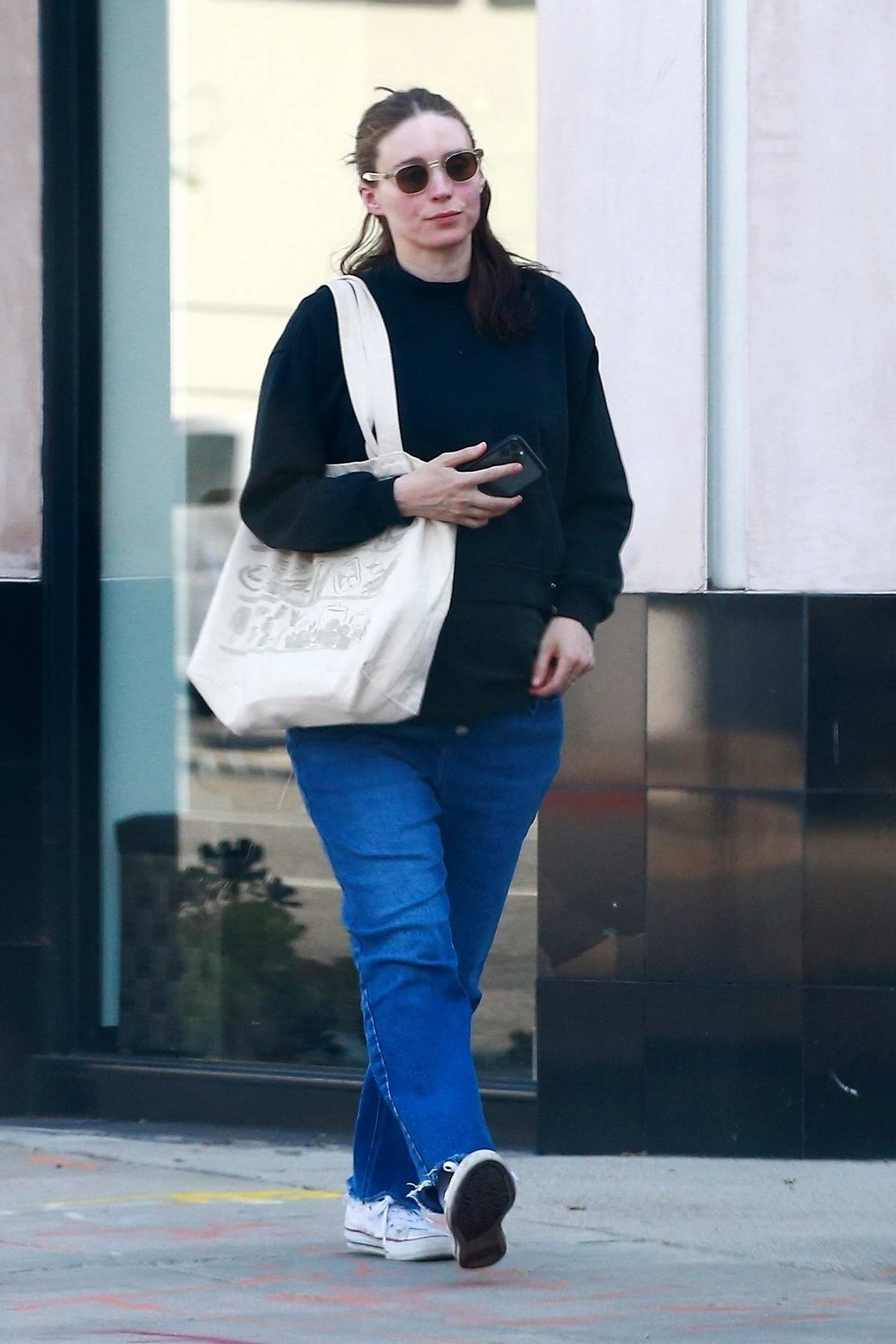 Rooney Mara covers up her baby bump in an oversized sweatshirt as she enjoys a spa day in Los Angeles