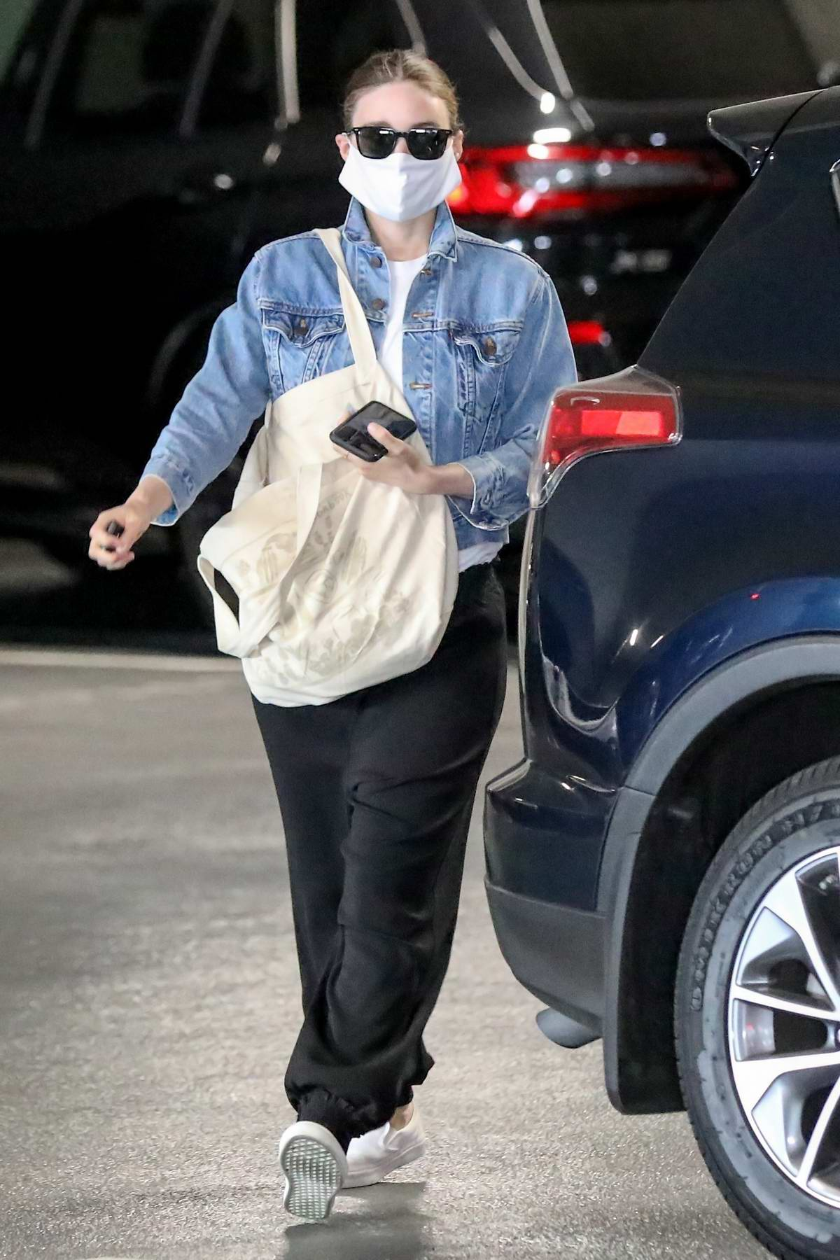 Rooney Mara covers up her belly with a bag as she heads to an appointment in Beverly Hills, California
