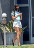 Sara Sampaio wears a tie-dye tee and denim shorts as she takes her dogs for grooming in Los Angeles