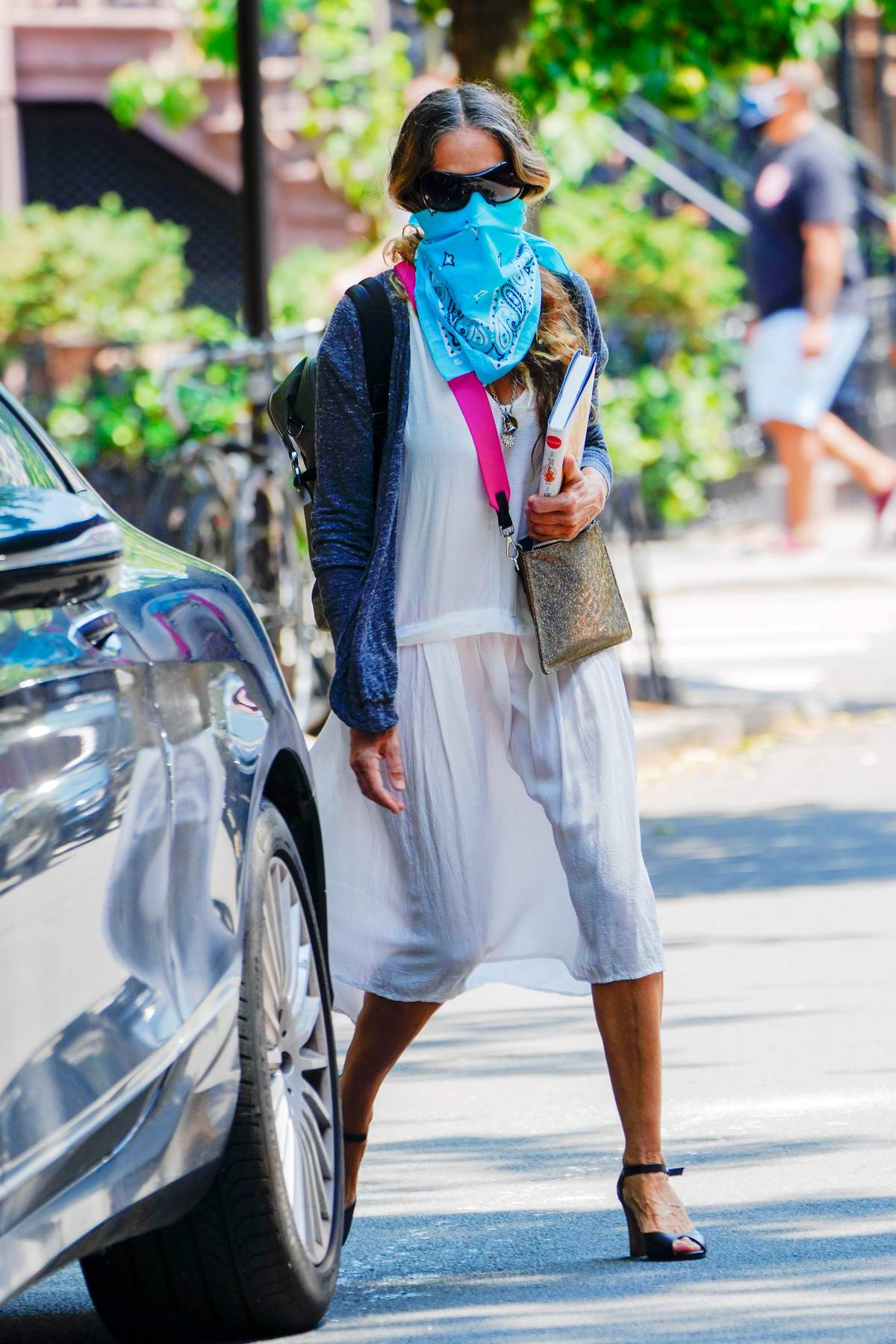 Sarah Jessica Parker seen holding a book as she leaves her house with husband Matthew Broderick in New York City