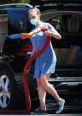 Scarlett Johansson seen wearing a blue mini dress while cleaning her SUV in The Hamptons, New York