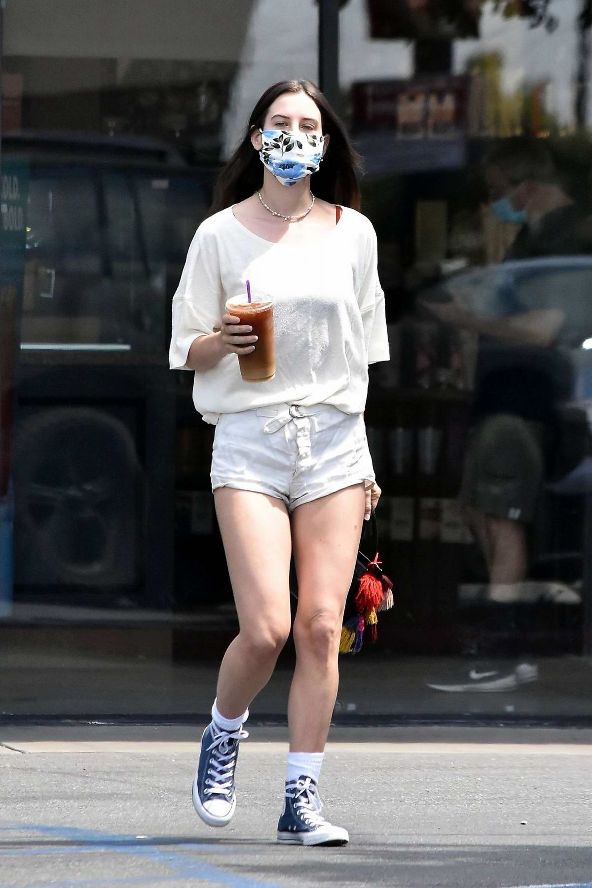 Scout Willis puts on a leggy display in shorts while making a coffee run in Los Feliz, California