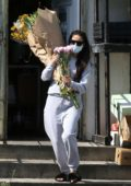 Shay Mitchell steps out in sweats to buy a few flower bouquets in West Hollywood, California