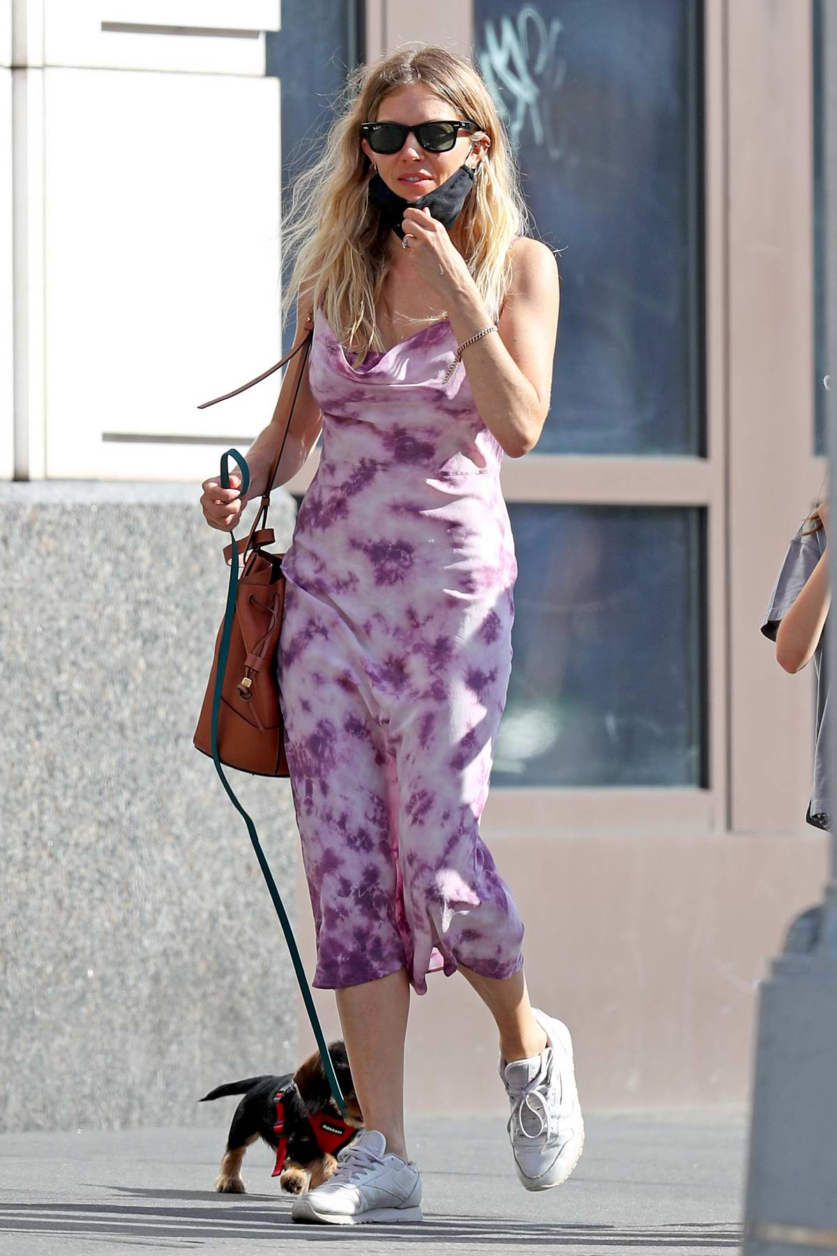 Sienna Miller wears a tie-dye dress while out with her daughter and boyfriend Lucas Zwirner in New York City